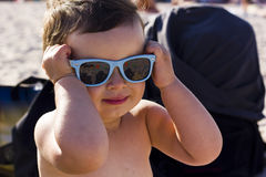 Little girl with sunglasses Stock Photos