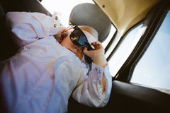 Little girl with sunglasses in the car Royalty Free Stock Photography