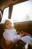 Little girl with sunglasses in the car Royalty Free Stock Photos