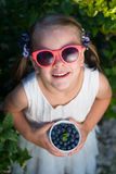 Little girl in sunglasses holding a bowl of blueberries - shallo Royalty Free Stock Photo