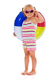 Little girl with sunglasses and inflatable ring Royalty Free Stock Photos