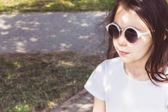 Little girl in sunglasses with loose hair royalty free stock images
