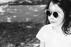 Little girl in sunglasses with loose hair, black and white image stock images