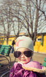 Little girl with sunglasses. Outdoors. Beautiful portrait Stock Photo