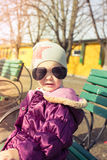 Little girl with sunglasses. Outdoors. Beautiful portrait Royalty Free Stock Photography