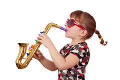 Little girl with sunglasses play music Stock Image