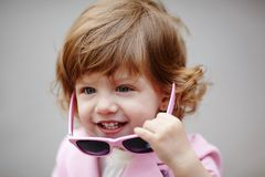 Little girl with sunglasses portrait Stock Photos