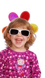 Little girl with sunglasses smiling Stock Photo