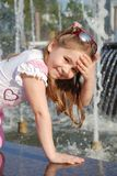 Little girl washes in the fountain Stock Image