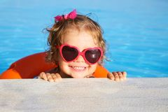 Little  girl sunning at the pool Stock Image