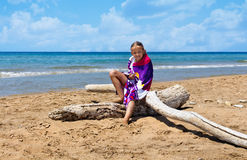 Little girl on the sunny deserted beach Stock Photo