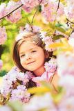 Little girl in sunny spring. Summer girl fashion. Happy childhood. Springtime. weather forecast. face and skincare stock image