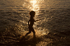 Little girl at sunset Royalty Free Stock Images