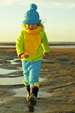 Little girl  on a sunset coast. Royalty Free Stock Photography