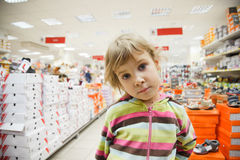 Little girl in supermarket alone Stock Photo