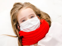 Little girl with surgical face mask for bacterial Royalty Free Stock Photos