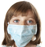 Little girl with a surgical mask Stock Photo
