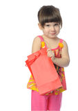 The little girl with surprise package Royalty Free Stock Images