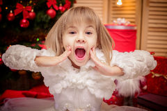 Little girl surprised  on a Christmas background Royalty Free Stock Photos