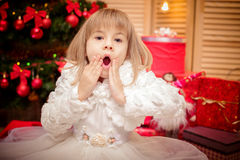 Little girl surprised  on a Christmas background Stock Images