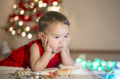 Little girl surprised. In the Christmas Eve royalty free stock photography