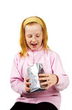Little girl surprised when opening present Royalty Free Stock Images