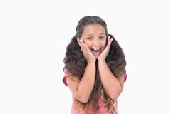 Little girl is surprising and smiling at camera Royalty Free Stock Photography