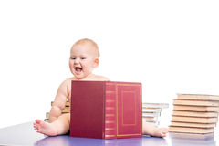 Little girl surrounded by books Royalty Free Stock Photography
