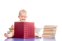 Little girl surrounded by books Stock Photography