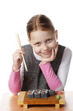 Little girl with sushi Stock Photography