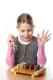 Little girl with sushi Stock Photo