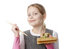 Little girl with sushi Stock Images