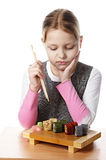 Little girl with sushi Stock Image