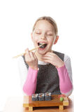 Little girl with sushi Stock Photos