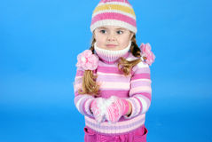 The little girl in a sweater and a hat Stock Photos