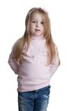 Little girl in sweater and jeans Stock Images