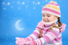 Little girl in a sweater with the snow Royalty Free Stock Images