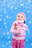 Little girl in a sweater with the snow Royalty Free Stock Photography