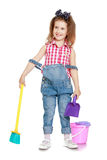 Little girl sweeping the floor Stock Photography
