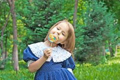 Little girl with sweet Royalty Free Stock Photos