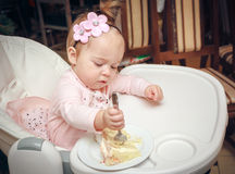 Girl with a sweet cake in birthday Royalty Free Stock Image