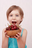 Little girl with sweet cherries. Little girl with the bowl of cherries Royalty Free Stock Photo