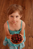 Little girl with sweet cherries. Little girl with a bowl of sweet cherries, view from above royalty free stock image