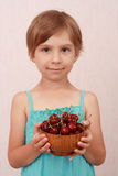 Little girl with sweet cherries. Little girl holding a bowl of cherries stock photography