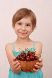 Little girl with sweet cherries Stock Images