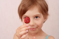 Little girl with sweet cherries. Little girl showing a cherry royalty free stock photo