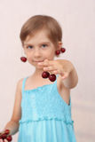 Little girl with sweet cherries Royalty Free Stock Photography