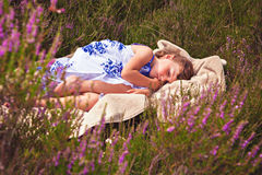 Little girl sweet dreaming in heather Royalty Free Stock Image