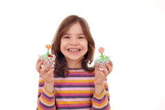 Little girl with sweet muffin Stock Image