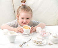 Little girl with sweets around her Royalty Free Stock Images